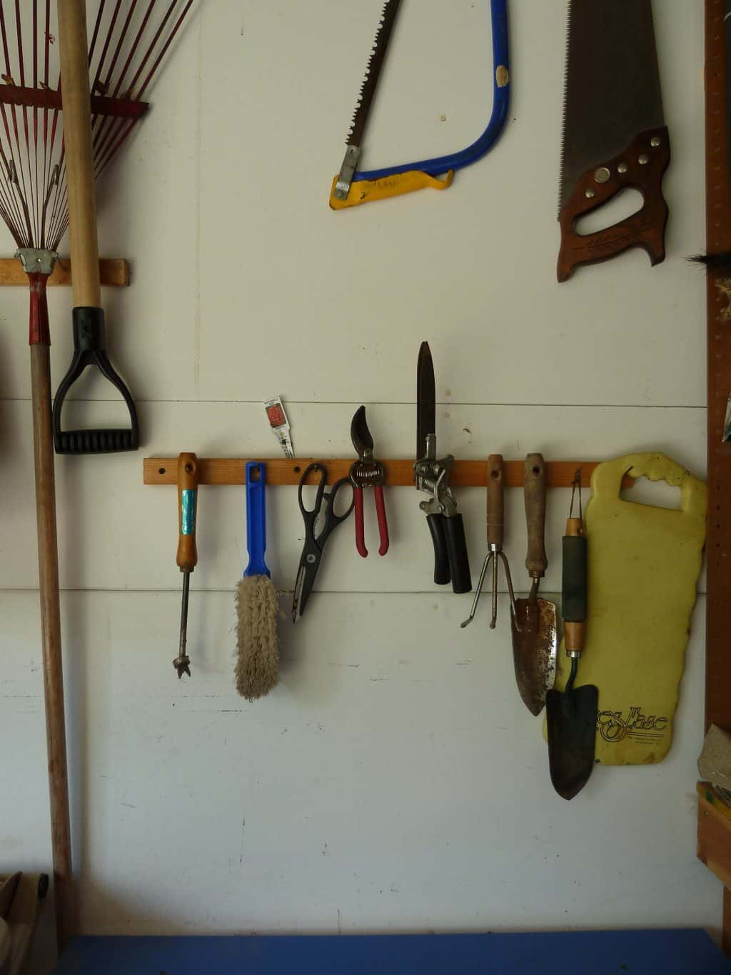 Garage tip a solution for organizing large yard tools for Gardening tools organizer