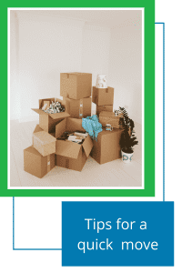 tan moving boxes opened and unopened piled on floor with white background and white floor